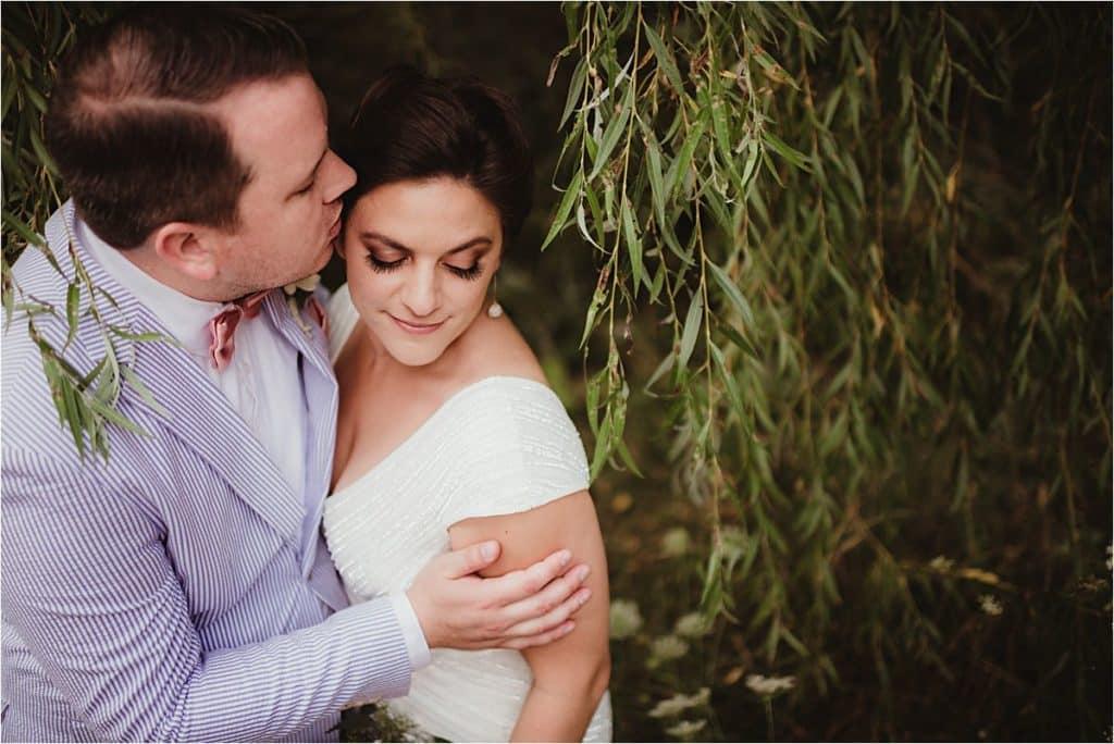 Summer Wedding Reception Groom Kissing Bride's Forehead
