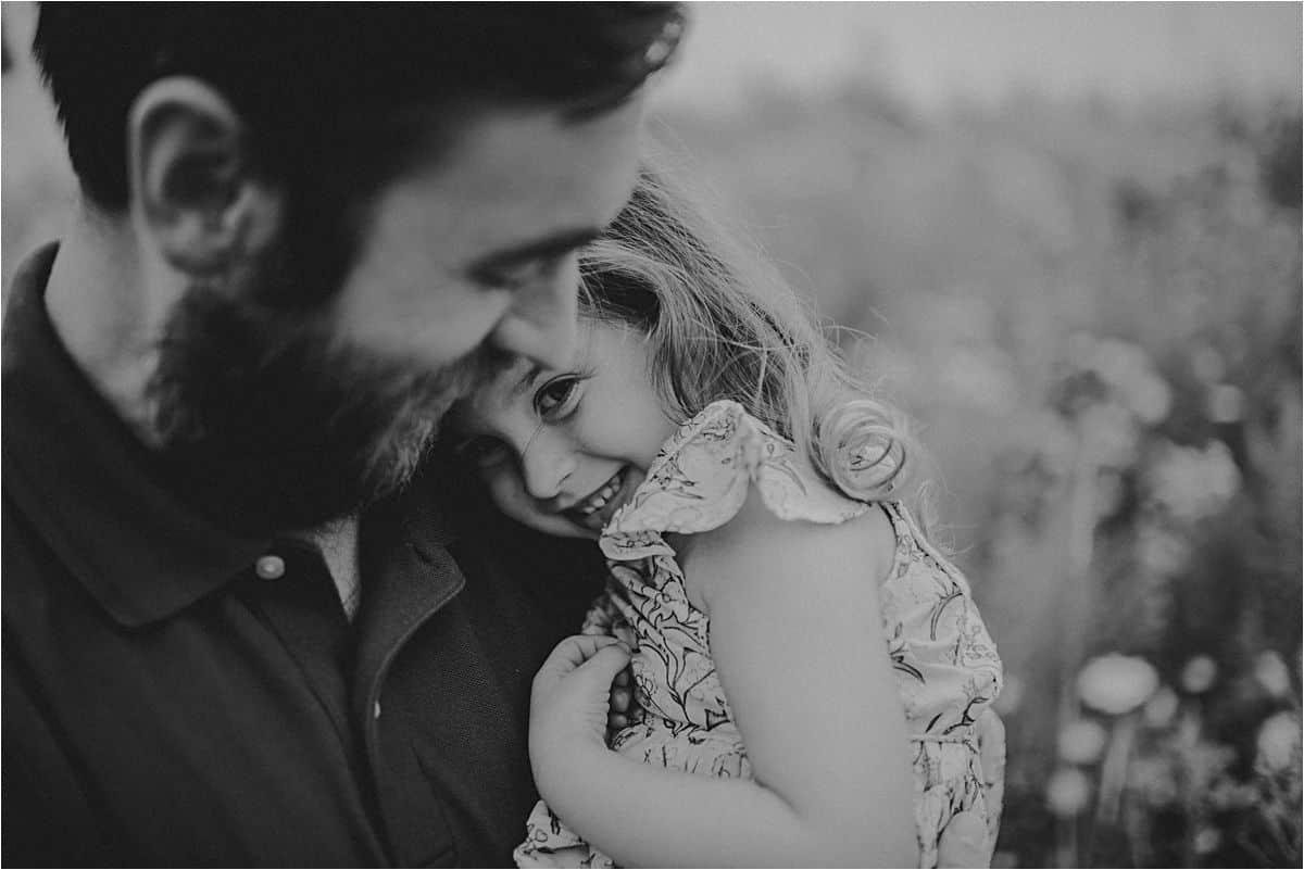 Dad Snuggling Daughter