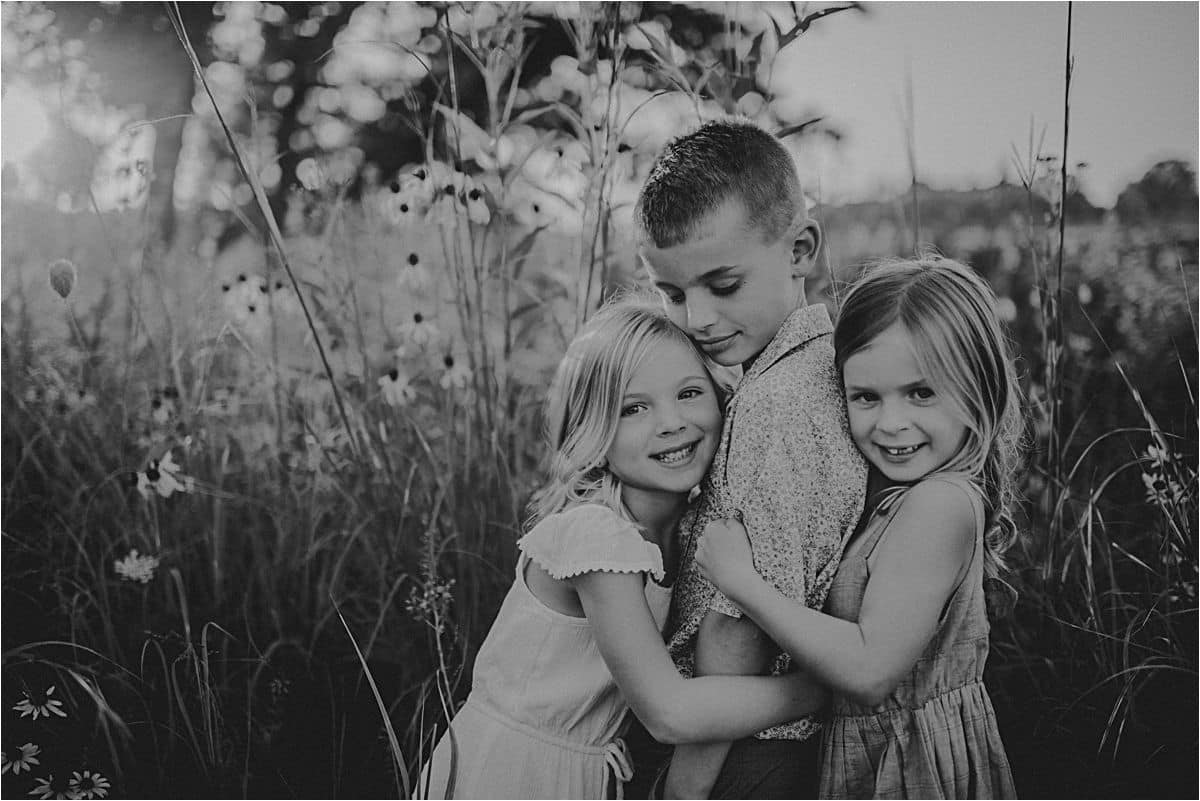 Sisters Hugging Brother