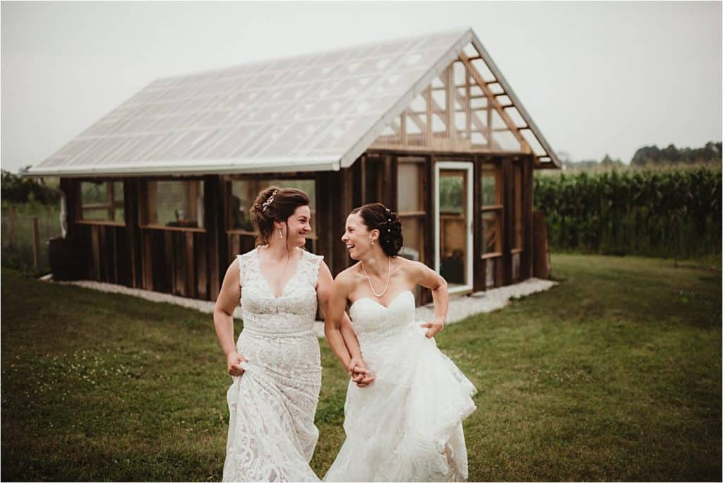 Brides Holding Hands Laughing